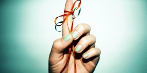 Reminder Ribbon Tied to Finger